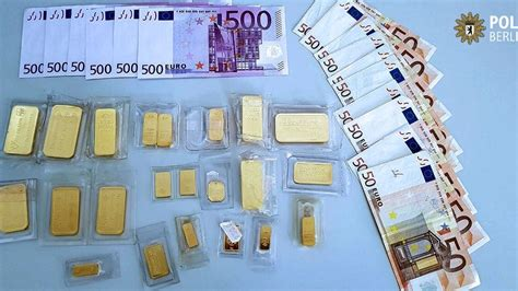 Bag of gold bars and cash worth £30k found under tree in