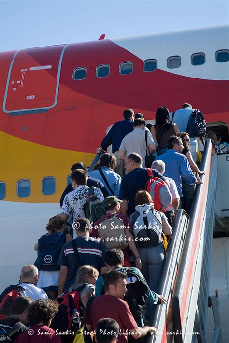 Passengers boarding a plane at Madrid-Barajas Airport