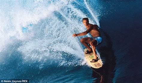 Laird Hamilton toppled by tiny surf during morning paddle
